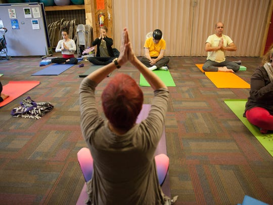 Eileen Cleland instructs a yoga class Monday morning,