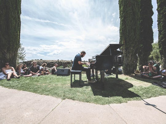 Bing & Ruth performs on a grand piano overlooking the