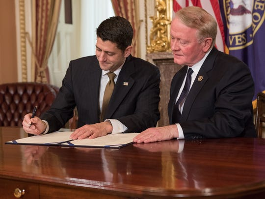 Speaker of the House of Representatives Paul Ryan signs