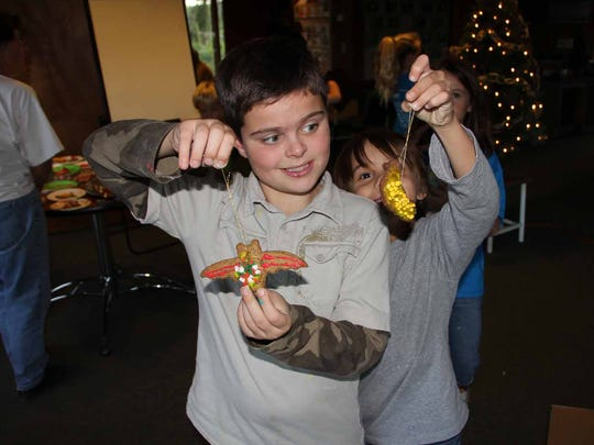 Children make ornaments at a previous Preserving the Holiday Spirit Open House at the Naples Preserve.