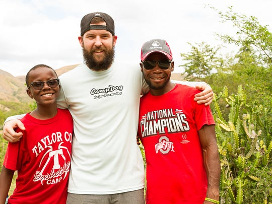 Ryan Alexander, Eli Heriges and Osner Jean Louis pose for a picture during the mission trip.