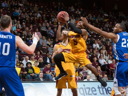 Former Mansfield Senior star Keon Johnson drives to the hoop for two of his career-high 40 points for Winthrop University against Big South rival UNC-Asheville.