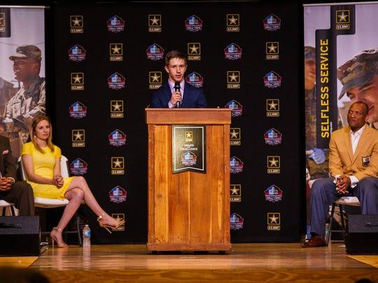 Cabool High School senior Logan Miller (center) addresses