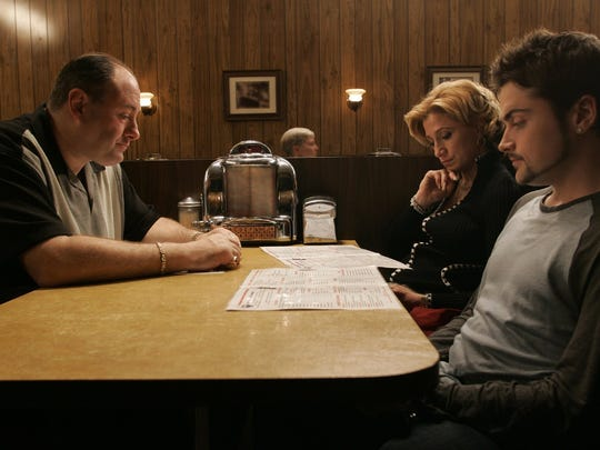"""James Gandolfini (from left), Edie Falco and Robert Iler check out the menu in the series finale of """"The Sopranos."""""""