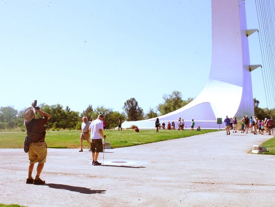 Tourists gather around the Sundial Bridge on June 21,