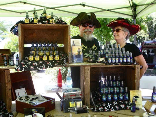 Ron and Janet Anderson of Wild At Heart Organic Farm sell essential oils at a local farmers market in Redding.
