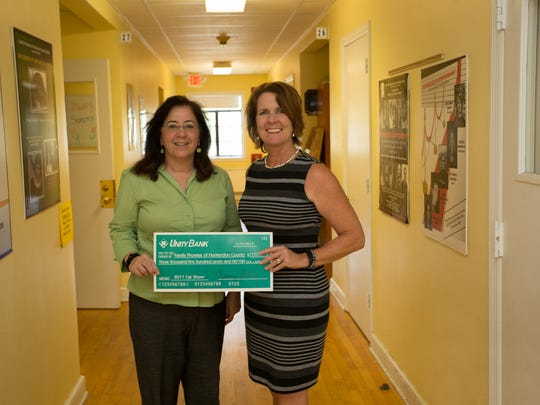Unity Bank Chief Marketing Officer Rosemary Fellner (left) presents a check to Colleen Duerr, development director of Family Promise of Hunterdon County.