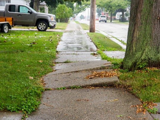 Sidewalks are shown in one Marine City neighborhood, among those chosen to be repaired or replaced by the residents.