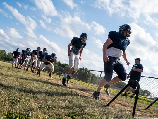 The Yale High School Bulldogs run drills during practice