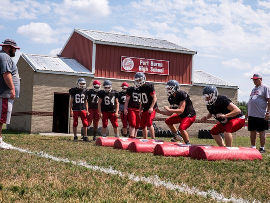 The Port Huron Big Reds run drills during practice on Aug. 14. The Big Reds' first game will be at Utica on Aug. 24.