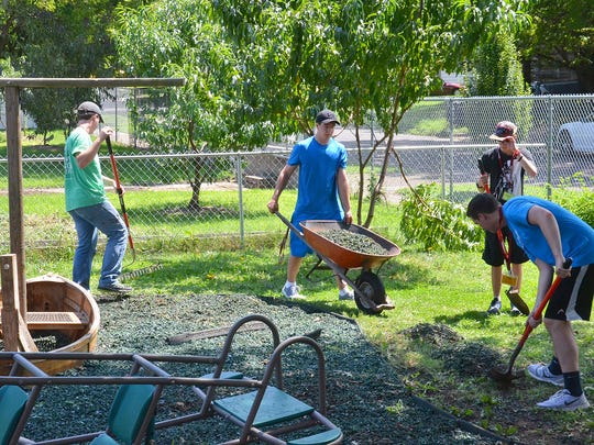 Several Evangel University freshmen cleaned the playground at the Fairbanks Community Center on Broadway.