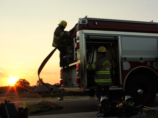 Firefighters with the Palo Cedro Volunteer Fire Company train with their equipment in a subdivision down the road from their station.