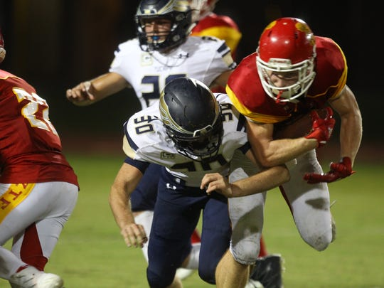 Palm Desert High School football, in red top uniforms, hosted Yucaipa High School on September 8, 2017.