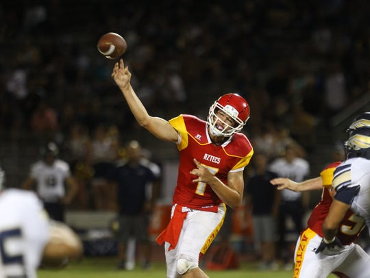 Palm Desert High School football, in red top uniforms,