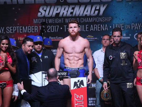 Canelo Alvarez.weighs in at 160 pounds at the MGM Grand Arena on September 15, 2017 for his bout against Gennady Golovkin.
