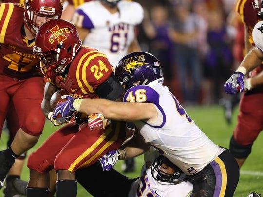 UNI linebacker Jared Farley makes a tackle versus Iowa