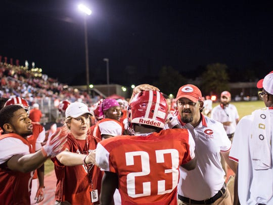October 06, 2017 - Germantown's Jaylin Williams, 23, is congratulated after scoring a touchdown during Friday night's game between White Station and Germantown.