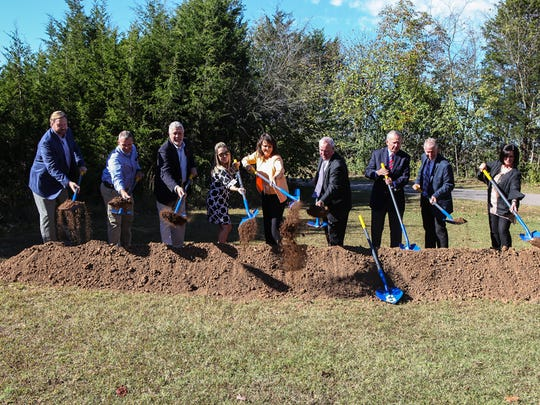 Tossing in the first shovels of dirt at the groundbreaking of the Capt. Jeff Kuss USMC Memorial are, from left, Alan Brandon, Mike Moss, Jerome Dempsey, Amber Hobbs, Mary Esther Reed, Harry Gill, Jimmie Taylor, John Black and Kellye Goostree on Tenn., Oct. 18, 2017.