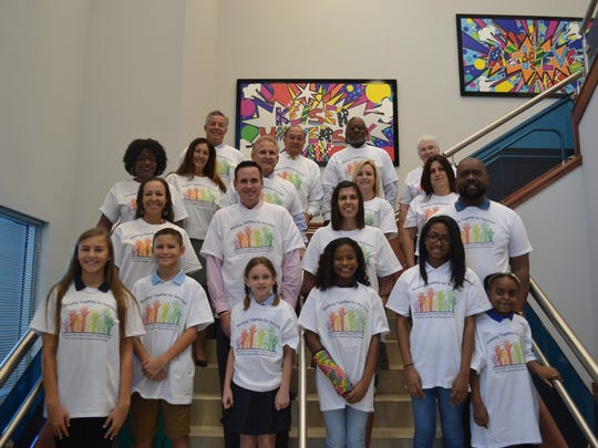 Pictured are Education Foundation, St. Lucie board members with students and parents from Palm Pointe Educational Research Institute.