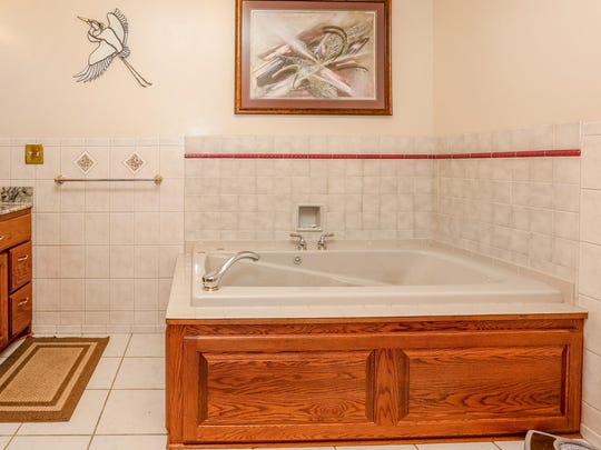 Relax in the bath at 7095 Island View Road NW, Sauk Rapids.