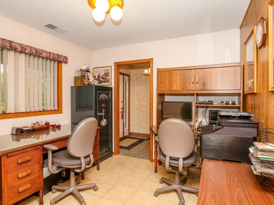 A spacious office is handy at 7095 Island View Road NW, Sauk Rapids.