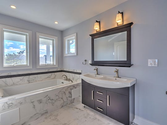 Enjoy the pleasures of his and her customize sinks in the spa-style master bathroom.