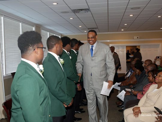 U.S Rep. Al Lawson congratulates Beautillion participants