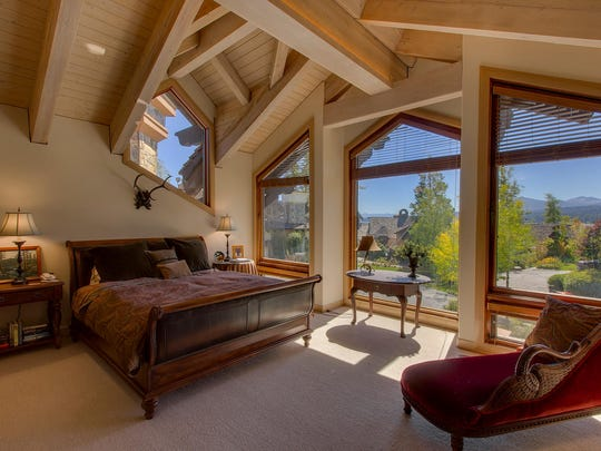 Soaring windows frame views of water and mountains from a bedroom of residence 13, for sale for $3.749 million at Fleur du Lac Estates on Lake Tahoe's West Shore.