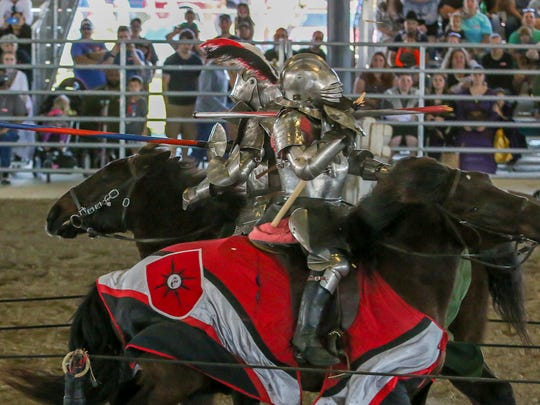 Sir Lawrence, in red, takes on Sir Theodore, in green, during the Gulf Coast Renaissance Faire and Pirate Festival at the Santa Rosa County Fairgrounds in Milton on March 3, 2018.