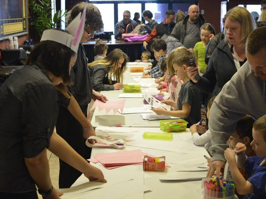 """Crafts and activities are part of the festivities at the Marcus Theatres' """"Hop to the Movies"""" event."""
