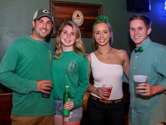 People celebrate St. Patrick's Day at O'Riley's Irish