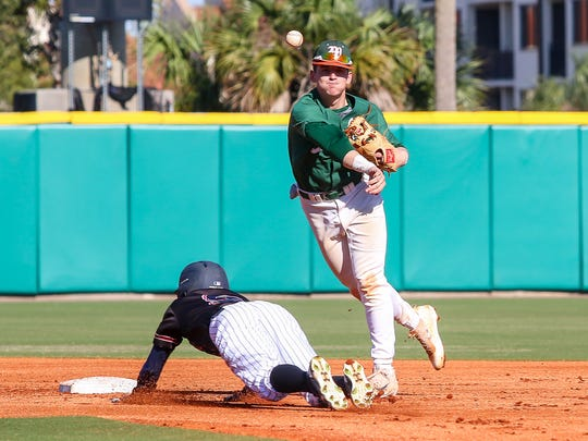 Mosley's Brayden Gainey (4) turns a double play after