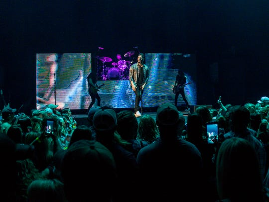 """Dylan Scott opens for Justin Moore during the """"Hell on a Highway"""" tour stop at the Pensacola Bay Center on Saturday, March 24, 2018."""