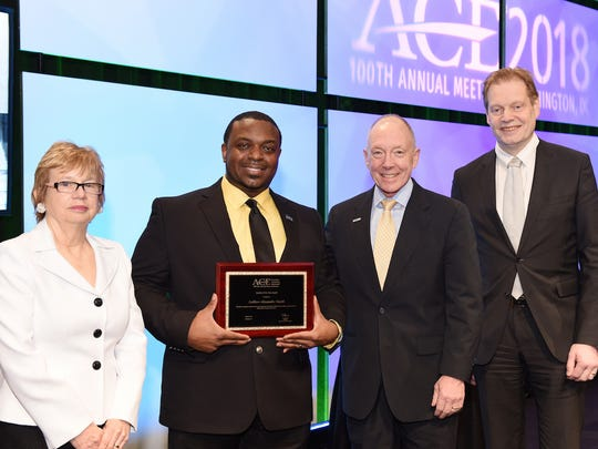 Left to right: Mary Beth Lakin, director of College and University Partnerships, ACE; LaMarr Smith, TESU student and 'Student of the Year' honoree; Ted Mitchell, president, ACE; and Marten Roorda, CEO, ACT at ACE's annual conference on March 13 in Washington, D.C.