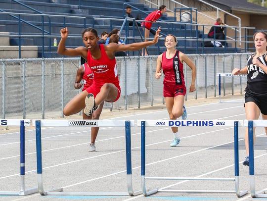 Pine Forest's Koriyunna Arrington wins the 300m hurdles