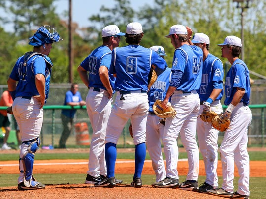 UWF head baseball coach Mike Jeffcoat (32) comes out to talk to his team after a balk by pitcher Hunter Lucas (34) during the game against West Georgia on Jim Spooner Field at the University of West Florida on Saturday, March 31, 2018.