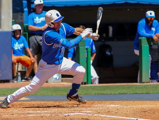 UWF's Joey Bend (24) hits an RBI single, scoring Jacob