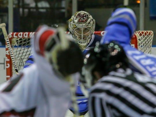 Pensacola goaltender Brian Billett (30) focuses on