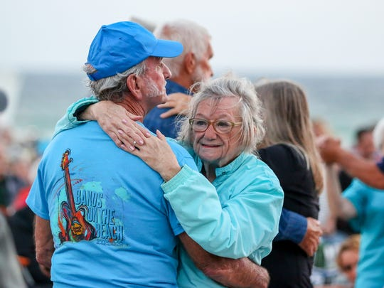 Hundreds of people enjoy a night of Bands on the Beach at the Pensacola Beach Gulfside Pavilion. The free, weekly concert series features a different band every Tuesday at 7 p.m.