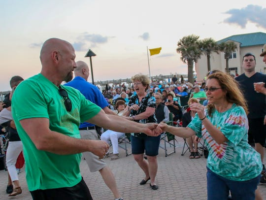 Hundreds of people enjoy a past Bands on the Beach concert at the Pensacola Beach Gulfside Pavilion. The free, weekly concert series features a different band every Tuesday.