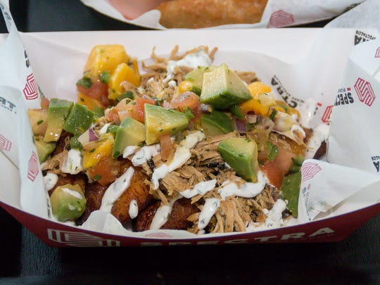 Deluna Chicken is one of the new creations of new Blue Wahoos executive chef Jason Perry. It features sweet mojo pulled chicken atop fried plantains and finished with a fresh mango & avocada salsa.