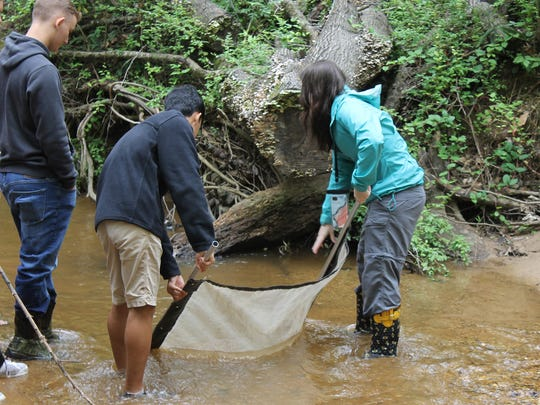 Over 50 students experienced pond exploration and creek seining in Still Creek during a visit to the Alabama Nature Center in Millbrook on April 9, 2018.
