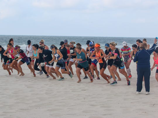 Racers compete in the 22nd annual Mullet Man Triathlon sponsored by the Flora-Bama Lounge, Package & Oyster Bar last year. The year's triathlon gets going at 7:30 a.m. Saturday, April 13.