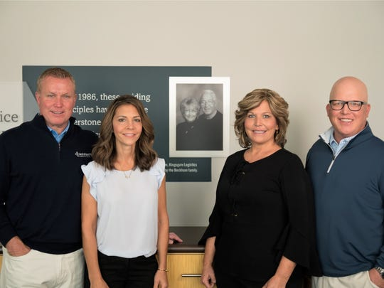 Kingsgate Logistics' second-generation owners and siblings are Jeff Beckham (left),  his wife Julie Beckham, Amy Barnett and David Beckham, with a picture of Kingsgate's founders, their parents, in the center.