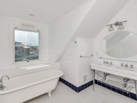 The Master bathroom features his and her sinks and tile flooring.
