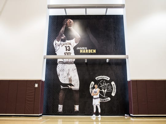 ASU signee Uros Plavsic poses at ASU's Weatherup Center in front of a giant mural of James Harden.