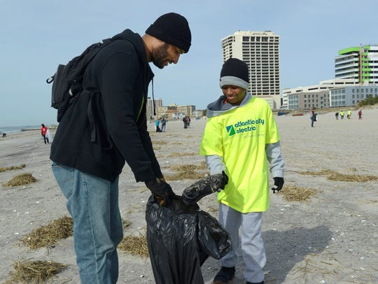 Atlantic City Electric employee Marcus Fortune, assisted