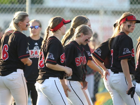 Members of the Stevens Point Area Senior High softball team watch Chippewa Falls celebrate a 4-1 victory in a Division 1 sectional final at Fire Pro Field on Thursday.