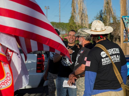 Michael Evans, who served four years in the U.S. Marine Corps, laughs with fellow vets on May 28 in Juárez.