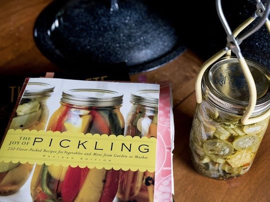 A book and jar of pickled produce at the McHaney's